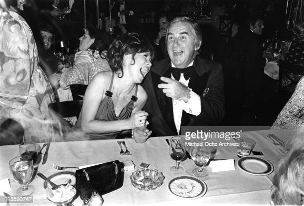 Ed McMahon announcer and sidekick on the Tonight Show with Johnny Carson and actress Michele Lee share a joke at a party after taping the 10th...