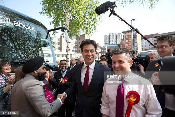Ed Miliband leader of the UK opposition Labour Party center arrives by battle bus to speak to Labour party supporters while campaigning for votes...