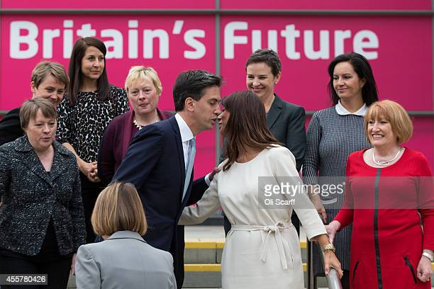 Ed Miliband the Leader of the Labour Party greets Gloria De Piero the Shadow Women and Equalities Minister as he arrives to pose for a photograph...