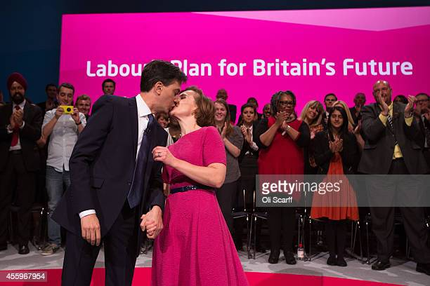 Ed Miliband the Leader of the Labour Party kisses his wife Justine Thornton after delivering his keynote speech to delegates in the main conference...