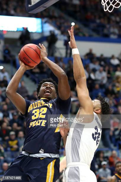 Ed Morrow of the Marquette Golden Eagles defends Darnell Cowart of the Murray State Racers during the first round game of the 2019 NCAA Men's...