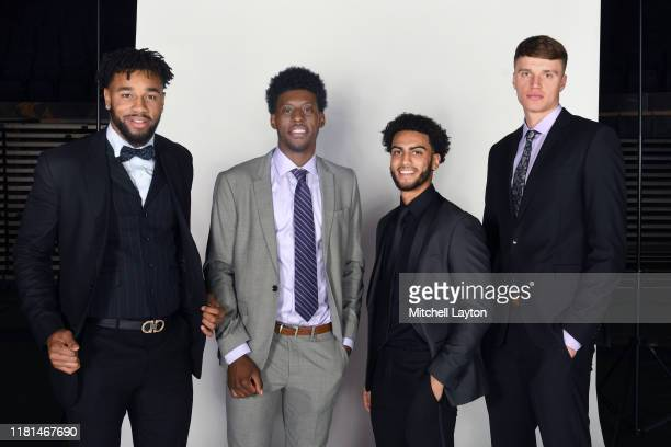 Ed Morrow, Sacar Amin, Markus Howard, and Jayce Johnson of the Marquette Golden Eagles poses for a portrait during Big East Basketball Media Day at...