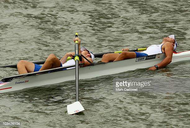 Ed NainbyLuxmoore and Caspar Jopling of Great Britain collapse exhausted after competing in the Junior Men's Pair Final A on day four of the...