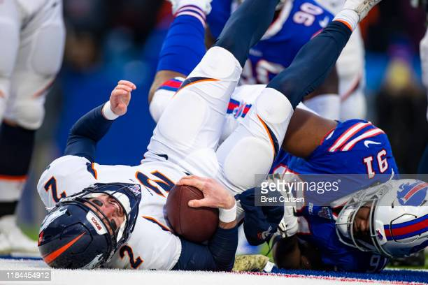 Ed Oliver of the Buffalo Bills sacks Brandon Allen of the Denver Broncos during the fourth quarter at New Era Field on November 24, 2019 in Orchard...