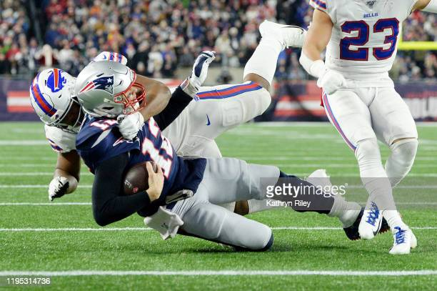 Ed Oliver of the Buffalo Bills tackles Tom Brady of the New England Patriots during the second half in the game at Gillette Stadium on December 21...