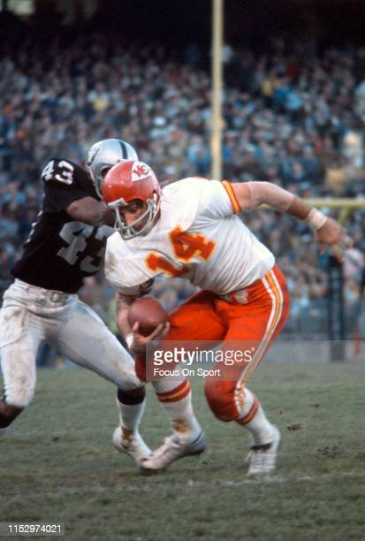 Ed Podolak of the Kansas City Chiefs gets tackled by George Atkinson of the Oakland Raiders during an NFL football game November 26 1972 at the...