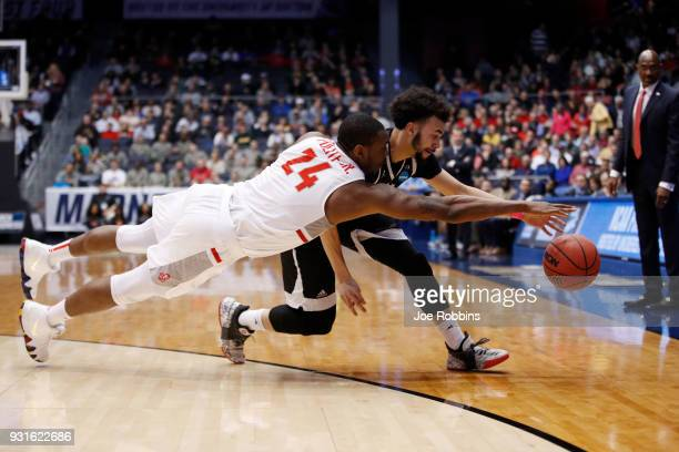 Ed Polite Jr #24 of the Radford Highlanders and Julian Batts of the Long Island Blackbirds battle for the ball during the second half of the First...