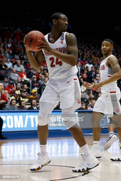 Ed Polite Jr #24 of the Radford Highlanders grabs a rebound during the game against the LIU Brooklyn Blackbirds at UD Arena on March 13 2018 in...