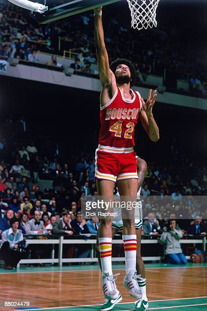 Ed Ratliff of the Houston Rockets goes in for the layup against Paul Silas of the Boston Celtics during a game played in 1975 at the Boston Garden in...