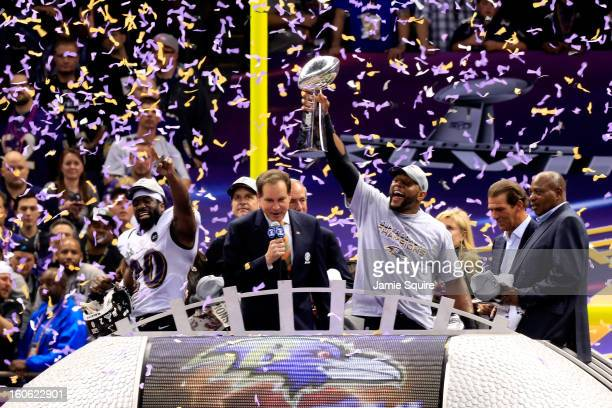 Ed Reed and Ray Lewis of the Baltimore Ravens celebrate after defeating the San Francisco 49ers as CBS Host Jim Nantz looks on during Super Bowl...