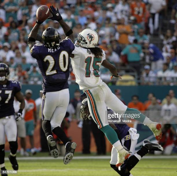 Ed Reed of the Baltimore Ravens breaks up a pass intended for Davone Bess of the Miami Dolphins during the AFC Wild Card Game at Dolphin Stadium on...