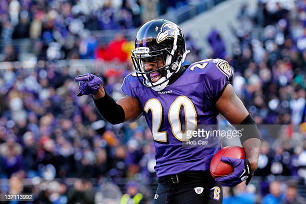 Ed Reed of the Baltimore Ravens celebrates his interception against Andre Johnson of the Houston Texans during the fourth quarter of the AFC...