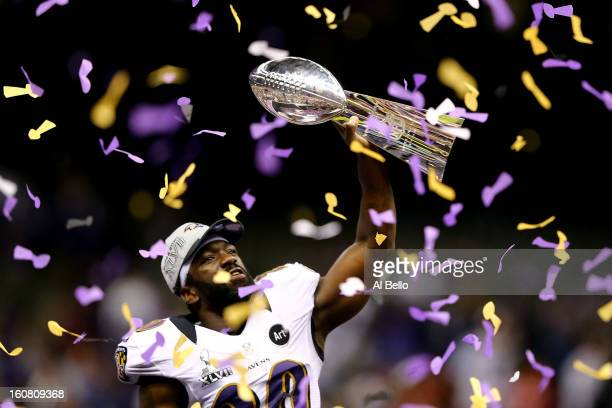 Ed Reed of the Baltimore Ravens celebrates with the Vince Lombardi Championship trophy as confetti falls after the Ravens won 3431 against the San...