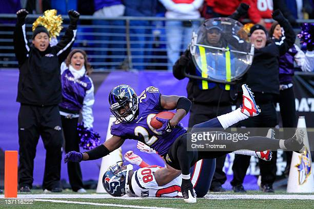 Ed Reed of the Baltimore Ravens intercepts a pass intended for Andre Johnson of the Houston Texans during the fourth quarter of the AFC Divisional...