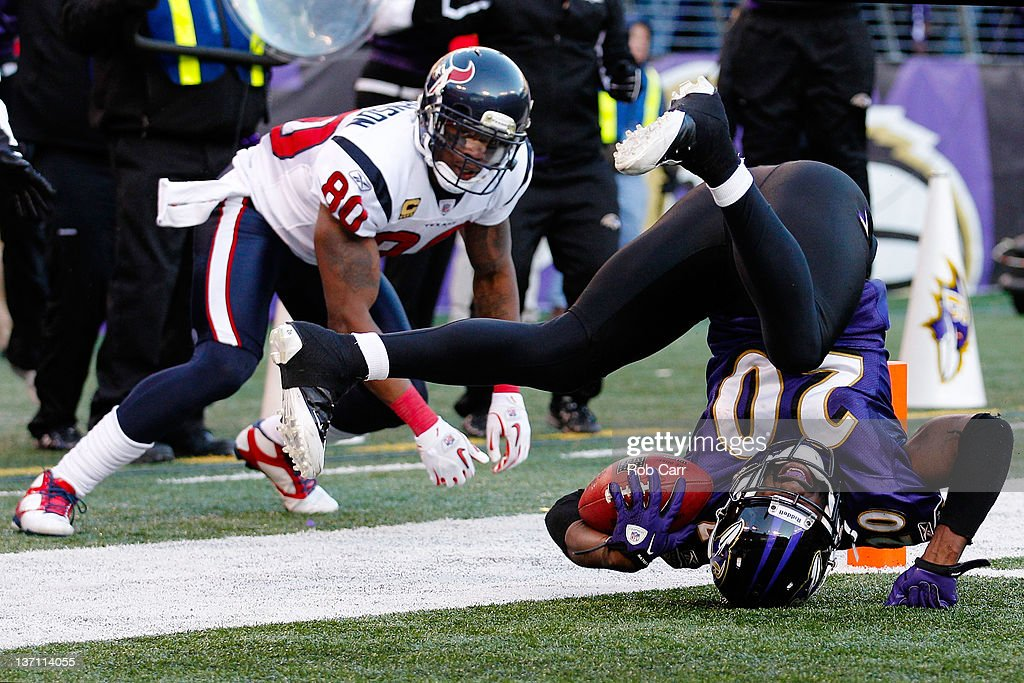 Ed Reed #20 of the Baltimore Ravens tumbles after intercepting the ball against Andre Johnson #80 of the Houston Texans during the fourth quarter of the AFC Divisional playoff game at M&T Bank Stadium on January 15, 2012 in Baltimore, Maryland.