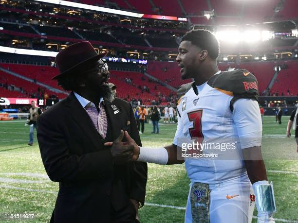 Ed Reed talks to Tampa Bay Buccaneers Quarterback Jameis Winston after the NFL game between the Tampa Bay Buccaneers and the Atlanta Falcons on...