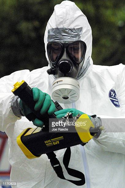 Ed Reimer from the Fort Lauderdale Fire Rescue Hazardous Materials Response Team prepares his detection device October 15 2001 as he responds to a...