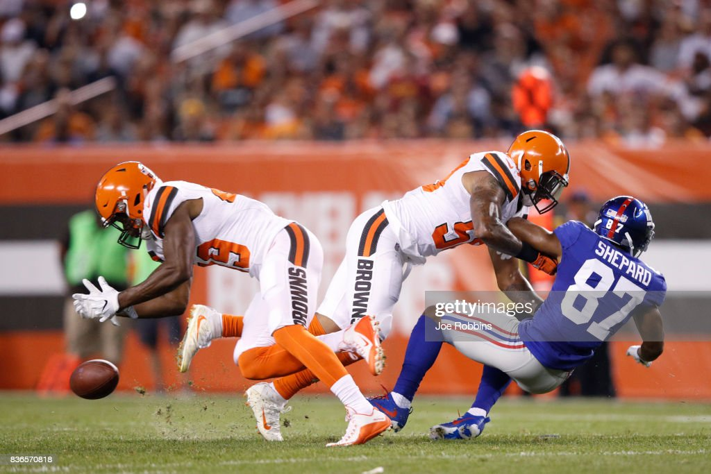 Ed Reynolds II #39 and Christian Kirksey #58 of the Cleveland Browns break up a pass against Sterling Shepard #87 of the New York Giants in the first half of a preseason game at FirstEnergy Stadium on August 21, 2017 in Cleveland, Ohio.