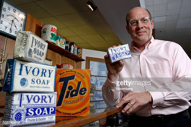 Ed Rider corporate archivist at Procter Gamble Co poses with old boxes of Tide detergent and Ivory Soap in the PG Archives at the company's...