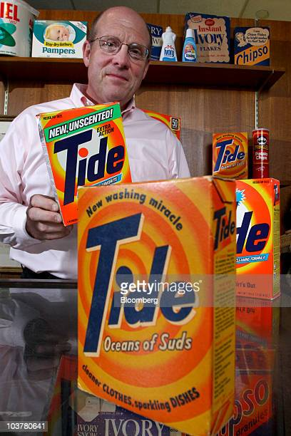 Ed Rider corporate archivist at Procter Gamble Co poses with old boxes of Tide detergent in the PG Archives at the company's headquarters in...