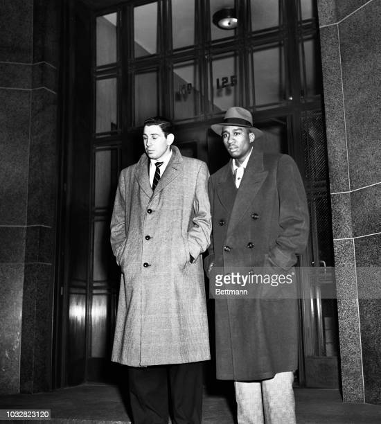 Ed Roman and Ed Warner , both stars on the City College of New York basketball team, leave the tombs after they were released on $15,000 bail each...