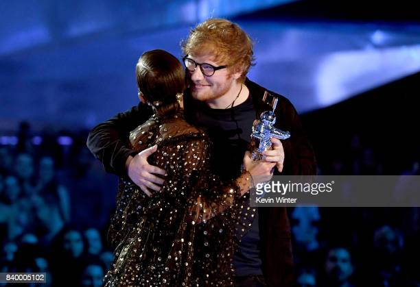 Ed Sheeran accepts the Artist of the Year award from Millie Bobby Brown onstage during the 2017 MTV Video Music Awards at The Forum on August 27 2017...