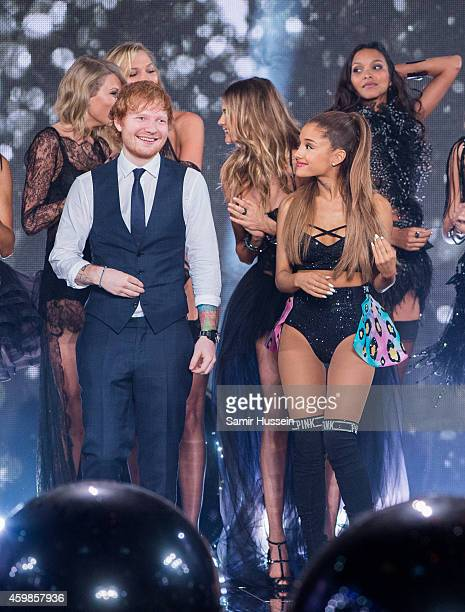 Ed Sheeran and Ariana Grande pose with models on runway at the annual Victoria's Secret fashion show at Earls Court on December 2 2014 in London...