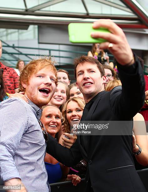 Ed Sheeran and James Blunt take a selfiewith fans on the red carpet ahead of the 29th Annual ARIA Awards 2015 at The Star on November 26 2015 in...