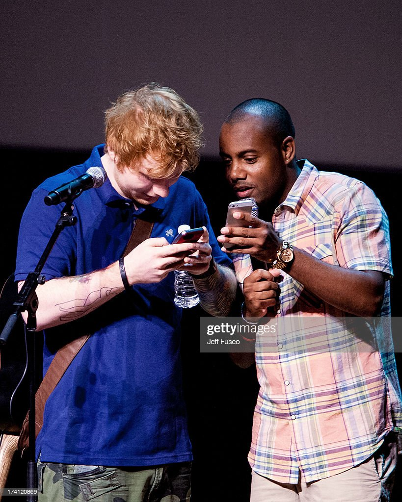 Ed Sheeran (L) and radio personality Maxwell tweet at a Q102 concert event at the Philadelphia Museum of Art on July 20, 2013 in Philadelphia, Pennsylvania.