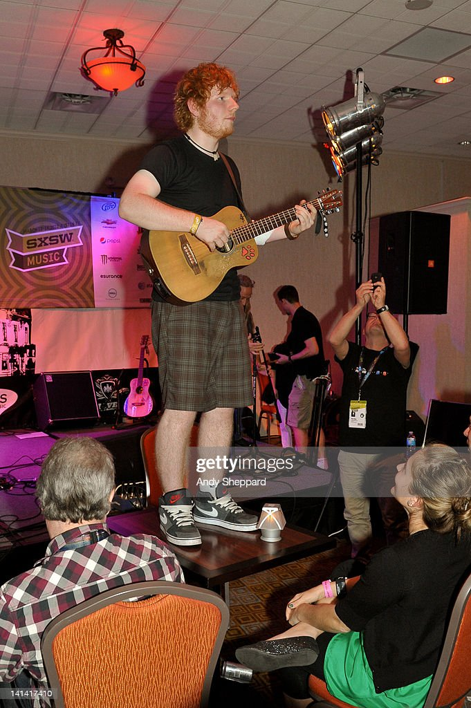 Ed Sheeran climbs upon a table to perform accoustically at The Bedford Showcase in The Hilton Creekside during SXSW 2012 Music Festival on March 15, 2012 in Austin, United States.