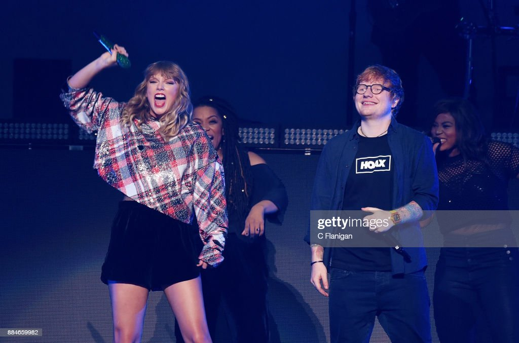 Ed Sheeran joins Taylor Swift onstage during the 99.7 NOW! POPTOPIA at SAP Center on December 2, 2017 in San Jose, California.