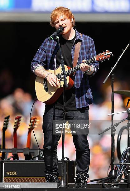 Ed Sheeran performs during the 2014 AFL Grand Final match between the Sydney Swans and the Hawthorn Hawks at Melbourne Cricket Ground on September 27...