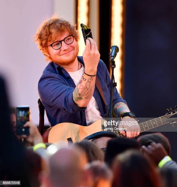 Ed Sheeran performs in Times Square for MTV's TRL on October 2 2017 in New York City