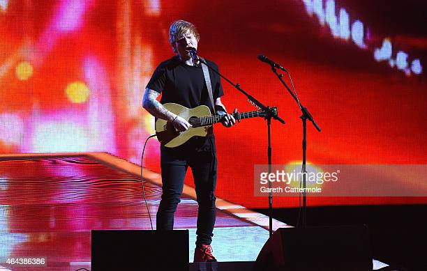 Ed Sheeran performs on stage during the BRIT Awards 2015 at The O2 Arena on February 25 2015 in London England