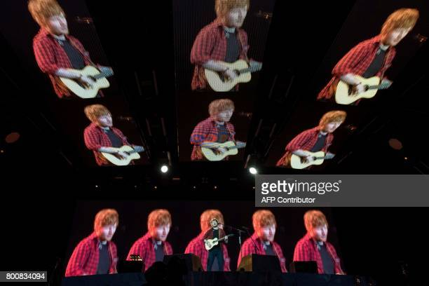 TOPSHOT Ed Sheeran performs on the Pyramid Stage at the Glastonbury Festival of Music and Performing Arts on Worthy Farm near the village of Pilton...