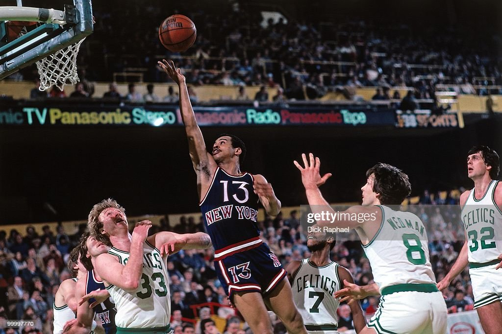 Ed Sherod #13 of the New York Knicks shoots a layup against Larry Bird #33 of the Boston Celtics during a game played in 1983 at the Boston Garden in Boston, Massachusetts.
