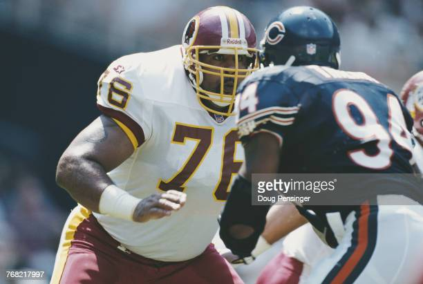 Ed Simmons, Offensive Tackle for the Washington Redskins prepares to block John Thierry, Defensive End for the Chicago Bears during their National...