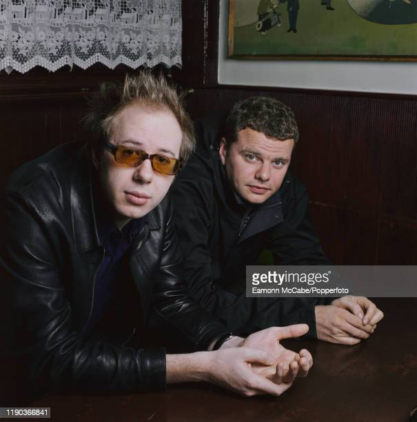 Ed Simons and Tom Rowlands of British dance music duo The Chemical Brothers posed together in a bar circa 2002