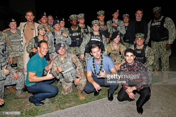 Ed Skrien Patrick Wilson Roland Emmerich Luke Kleintank Darren Criss and Harold Kloser stand with a group of soldiers before a special screening of...