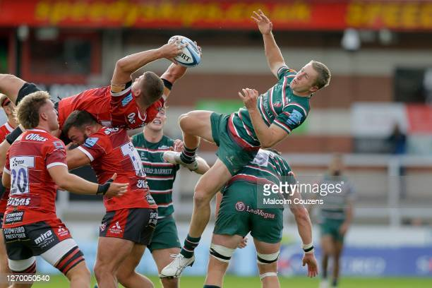 Ed Slater of Gloucester Rugby catches the ball ahead of Harry Potter of Leicester Tigers during the Gallagher Premiership Rugby match between...