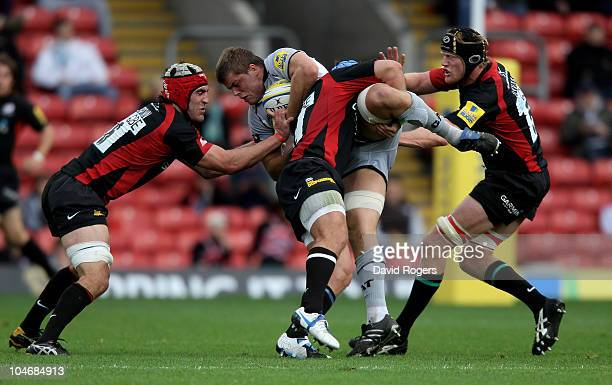 Ed Slater of Leicester is tackled by Schalk BritsKelly Brown and Hugh Vyvyan during the Aviva Premiership match between Saracens and Leicester Tigers...
