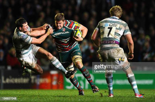 Ed Slater of Leicester Tigers is tackled by Declan Danaher of London Irish during the LV= Cup match between Leicester Tigers and London Irish at...