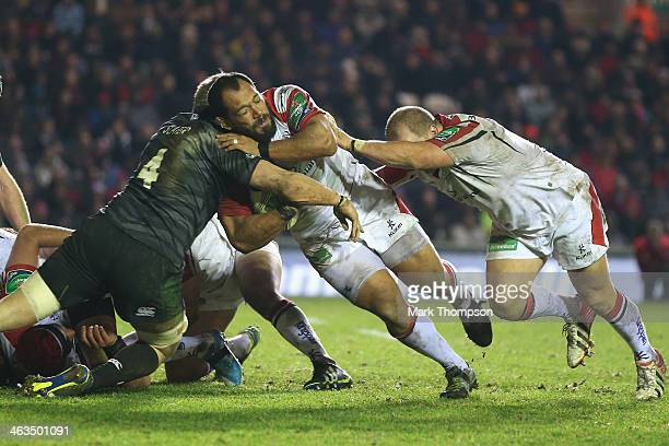 Ed Slater of Leicester Tigers tangles with John Afoa of Ulster during the Heineken Cup round 6 pool 1 match between Leicester Tigers and Ulster at...