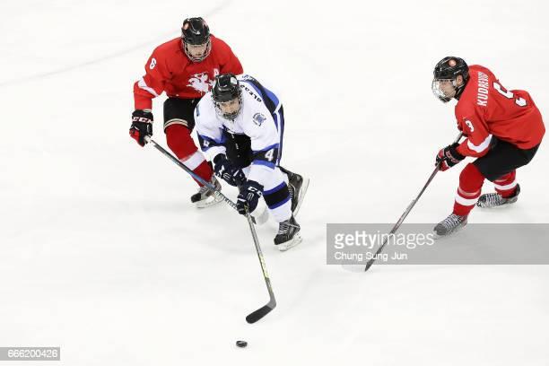 Ed Slessarevski of Estonia competes for the ball with Kostas Gusevas of Lithuania during the 2017 IIHF Ice Hockey U-18 World Championship Div II...