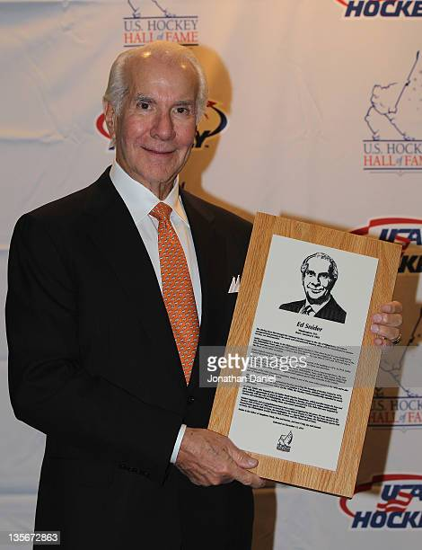 Ed Snider poses with his plaque during a media availability before the 2011 US Hockey Hall of Fame Induction at the Renaissance Chicago Hotel on...