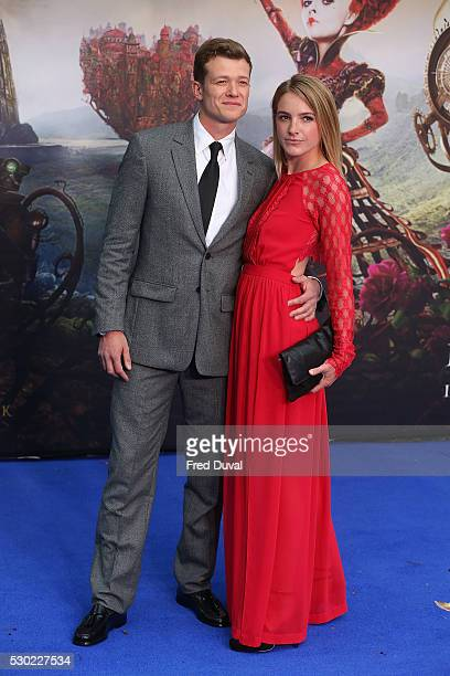 Ed Speleers and Asia Macey attend the UK Premiere of Alice Through The Looking Glass at Odeon Leicester Square on May 10 2016 in London England