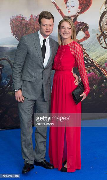 Ed Speleers and wife Asia Macey attend the European Film Premiere of Alice Through The Looking Glass at Odeon Leicester Square on May 10 2016 in...