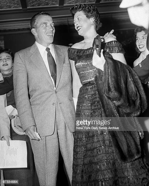 "Ed Sullivan and his wife Sylvia arrive at the Paramount for premiere of movie ""A Star is Born."","