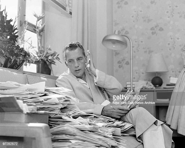 Ed Sullivan columnist for The News and TV personality looks over pile of letters from his fans Ed who started his fourweek vacation from The News...