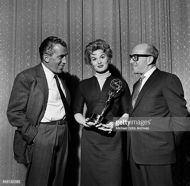Ed Sullivan poses with Anne Jeffreys as she holds her Emmy Award on 'Toast of the Town' show hosted by Ed Sullivan at the Maxine Elliott Theater in...
